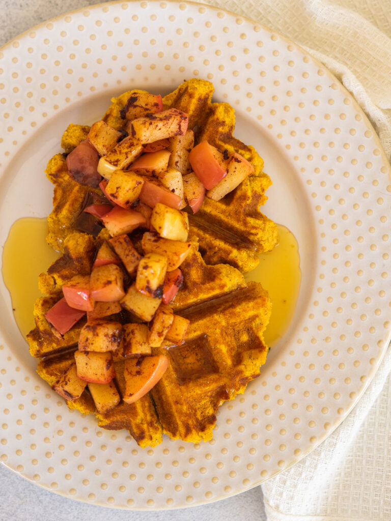 paleo pumpkin waffles with cinnamon apples and maple syrup