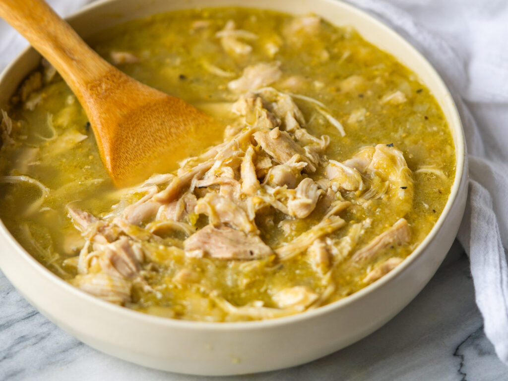 Close up three quarter view of salsa verde chicken made in instant pot