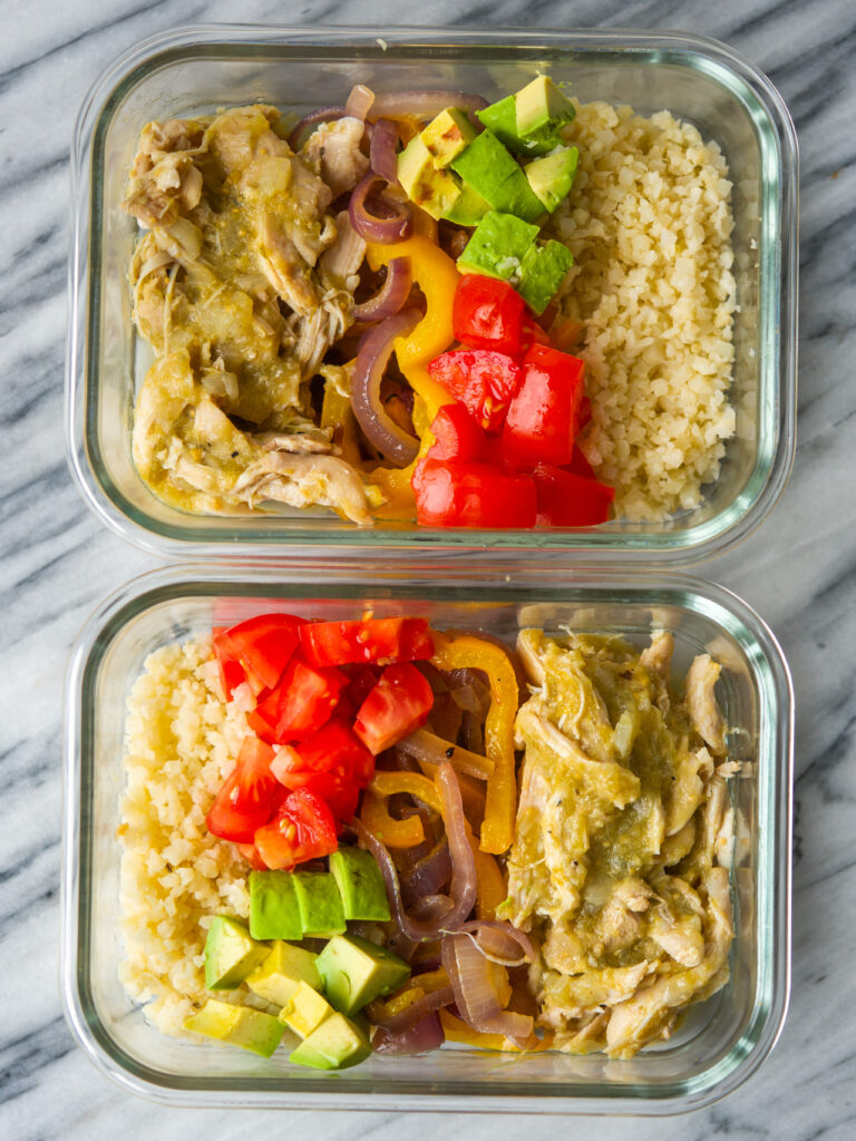 Above view of meal prep containers with salsa verde shredded chicken
