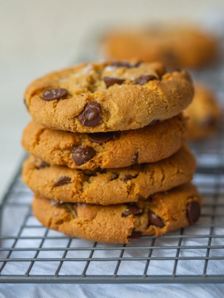 Stack of grain free cookies cooling on a cooling rack
