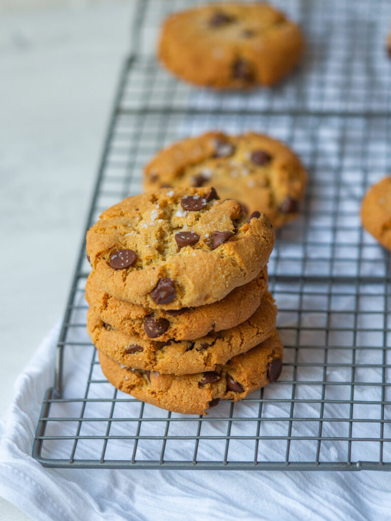 Three quarter view of grain free chocolate chip cookies on a cooling rack