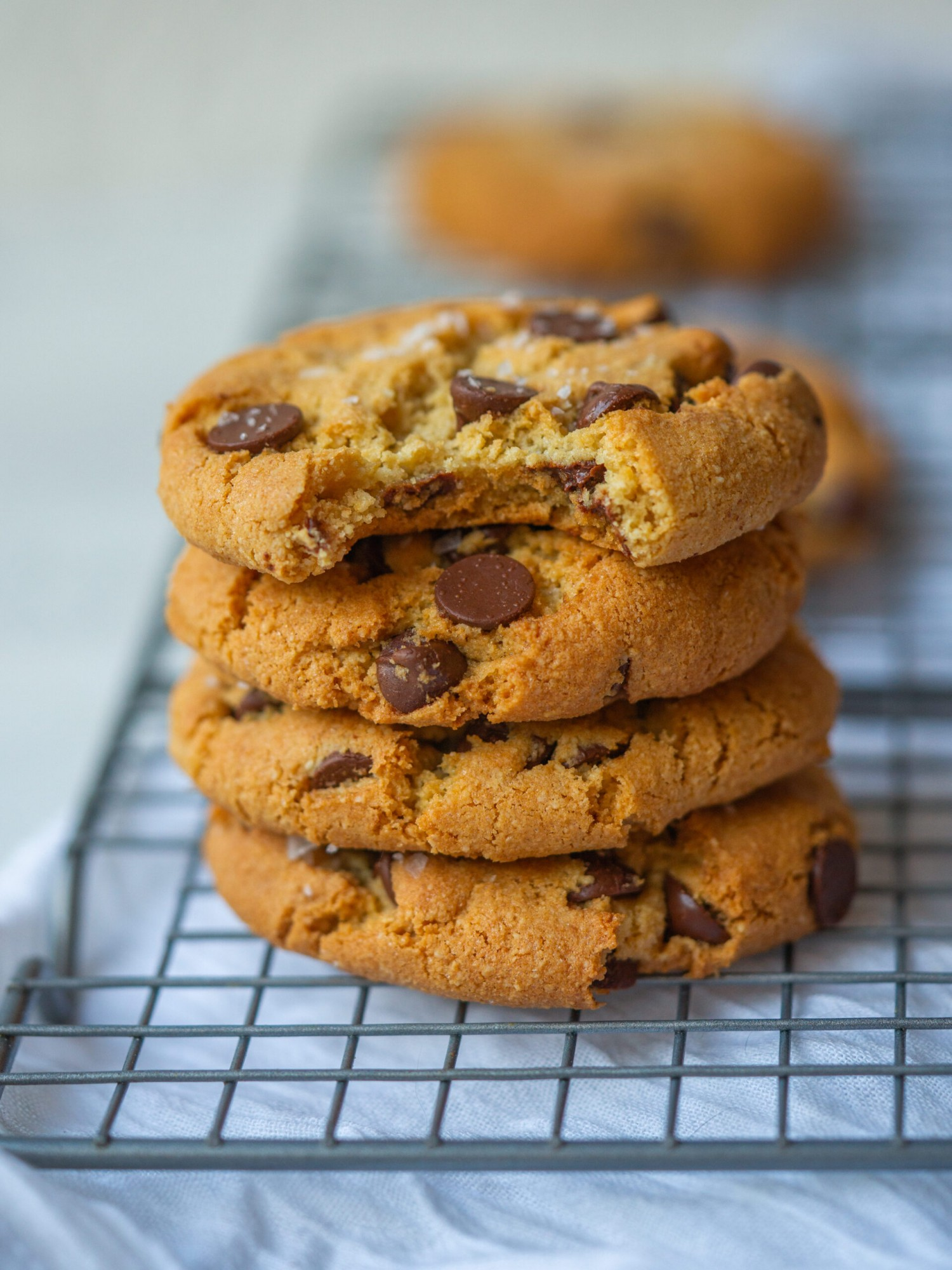 Stack of grain free chocolate chip cookies on a cooling rack