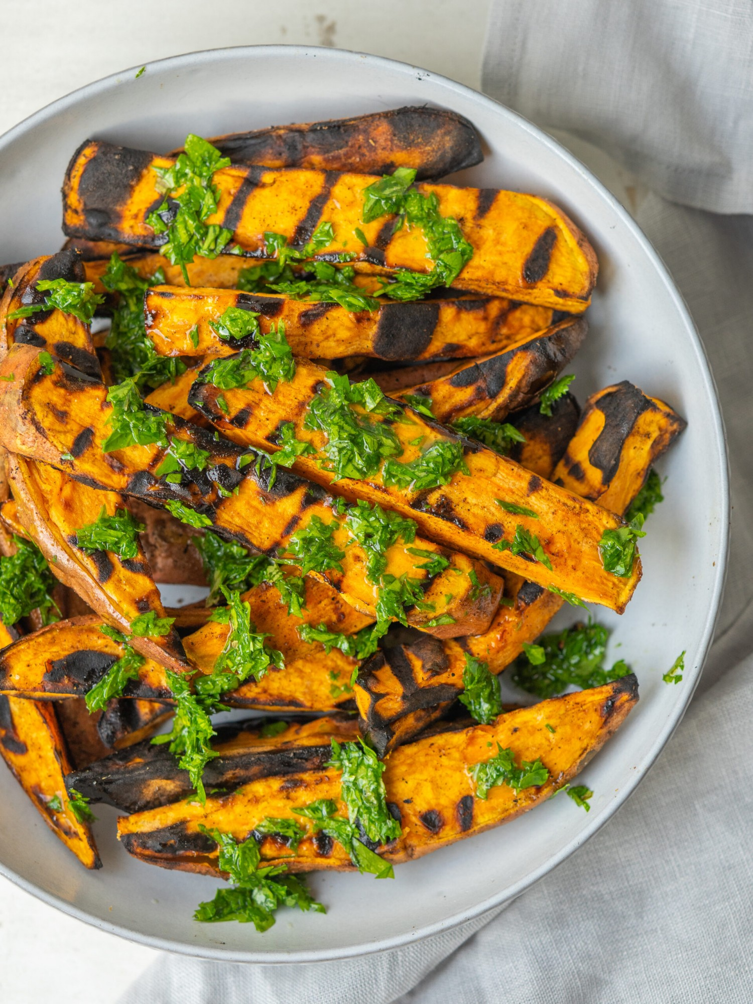 Close up above view of grilled sweet potato wedges recipe