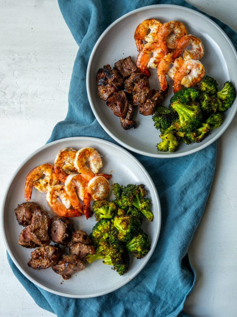 Above view of surf and turf dinners on serving plates