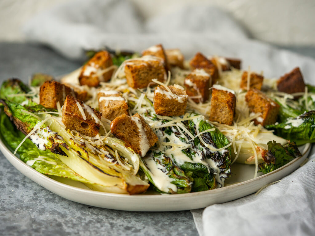 Side view of homemade grilled caesar salad recipe with homemade caesar dressing