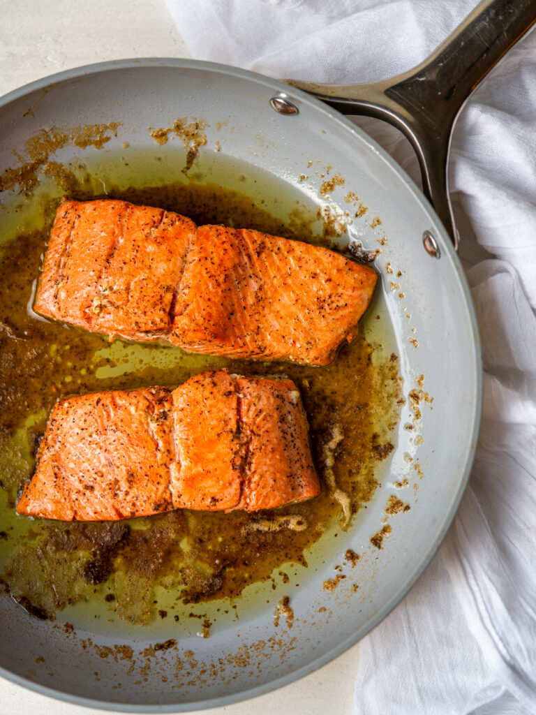 Above view of lemon pepper salmon filets in a pan