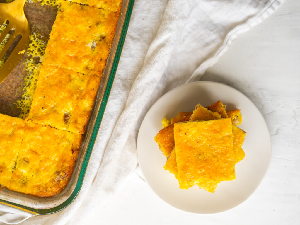 Above view of ground beef breakfast casserole with slices cut out