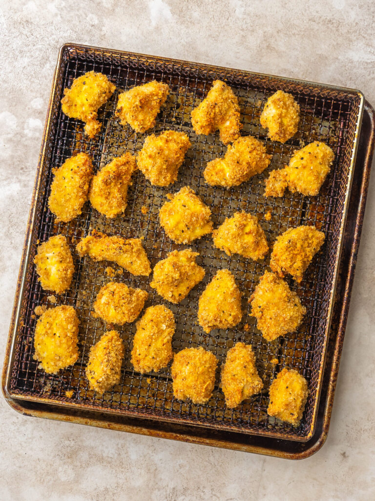 low carb air fryer chicken nuggets from above on a air fryer basket