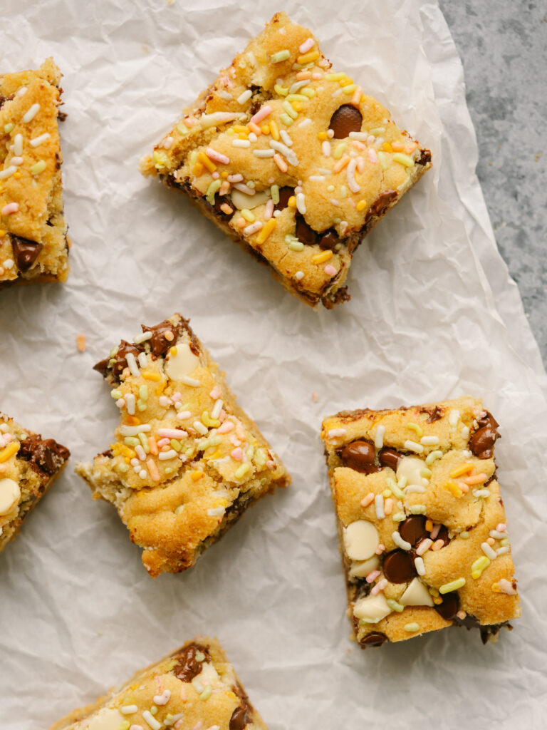 Above view of birthday cake bars on a piece of parchment paper