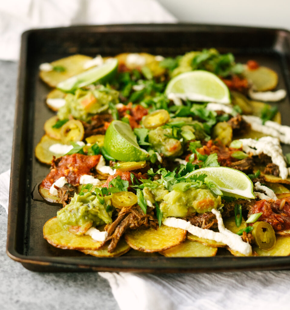 three quarter view of whole30 nachos with shredded barbacoa on top