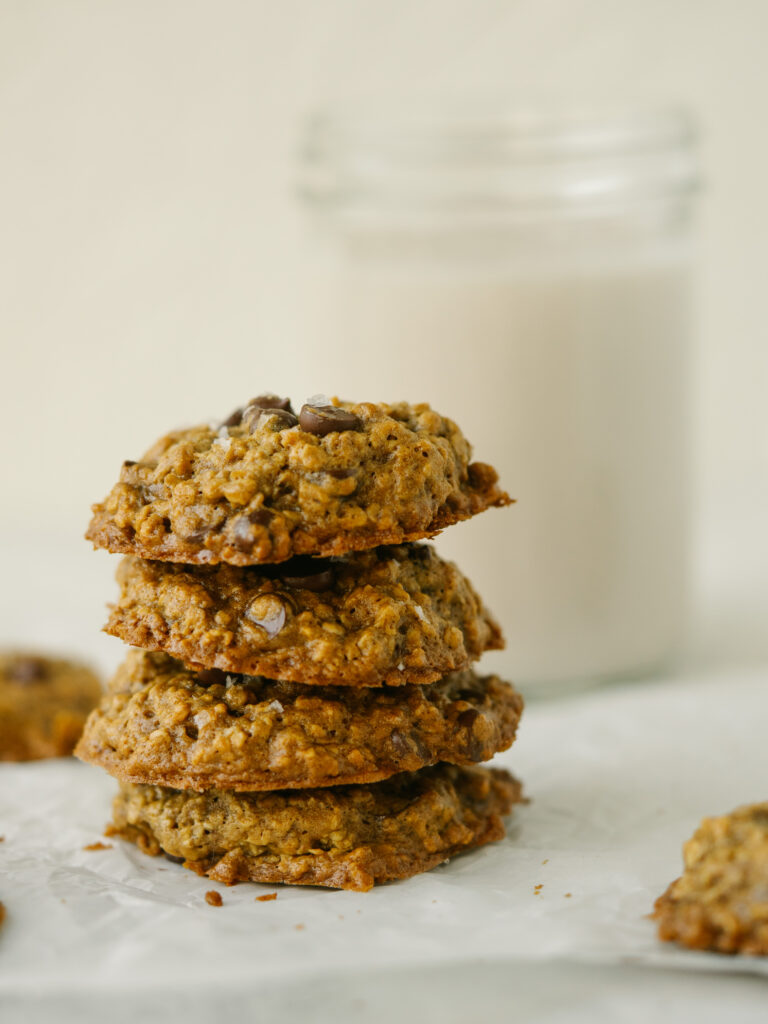 Side view of peanut butter oatmeal chocolate chip cookies stacked up