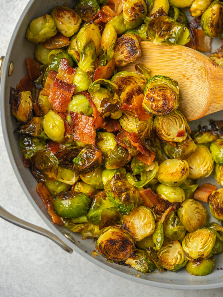 Close up above view of maple bacon brussels sprouts in a frying pan