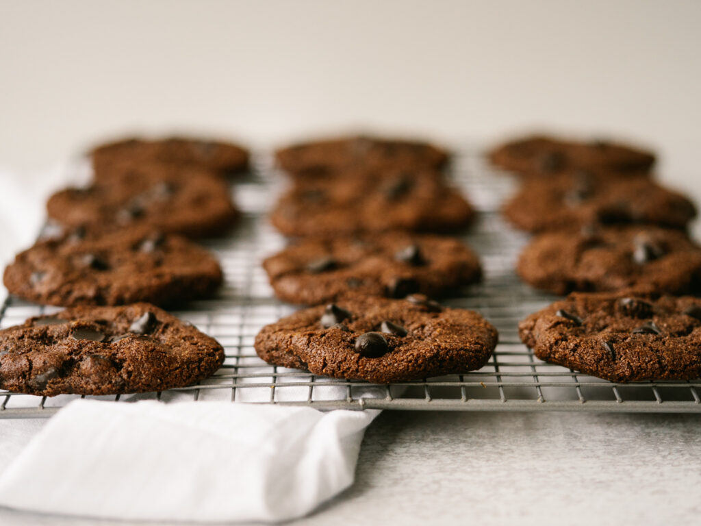 chocolate chip mocha cookies on a cooling rack