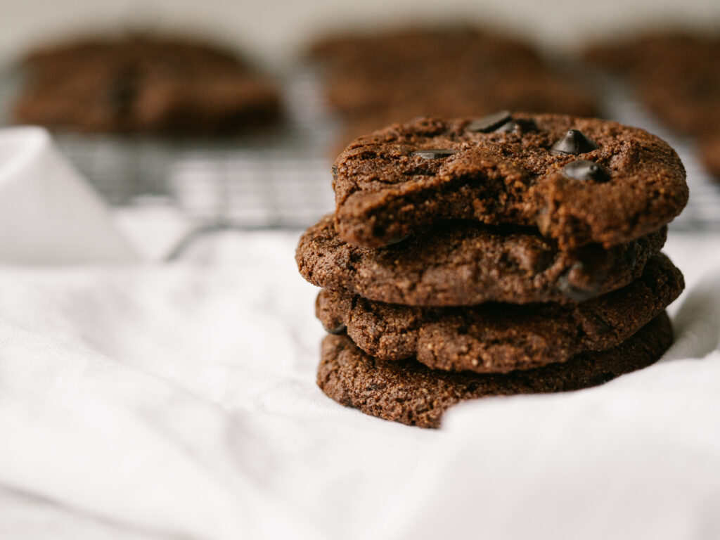 Stack of chocolate chip mocha cookies with more cookies in the background