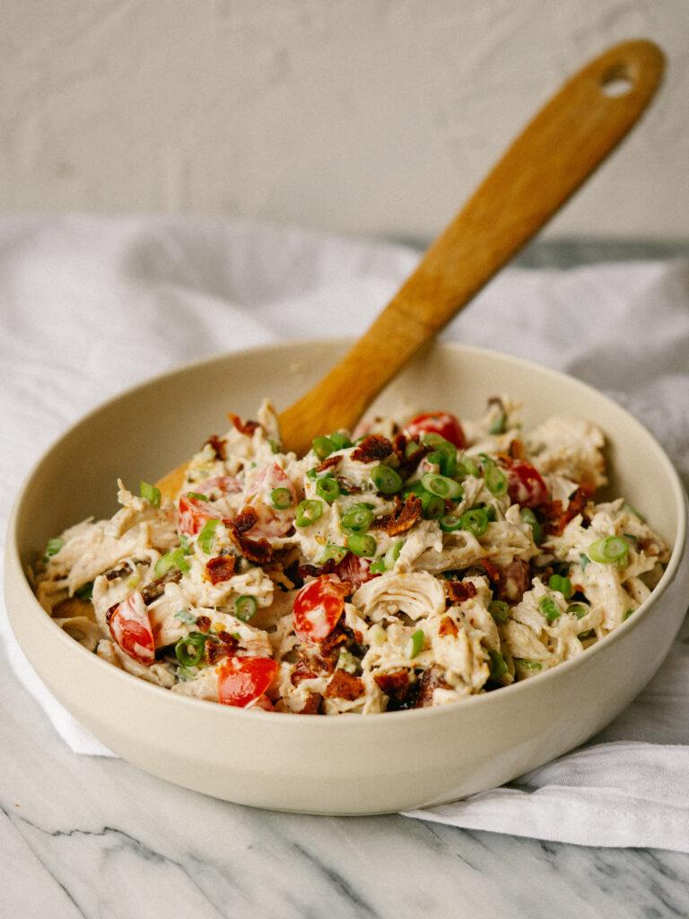 vertical image bowl of BLT chicken salad