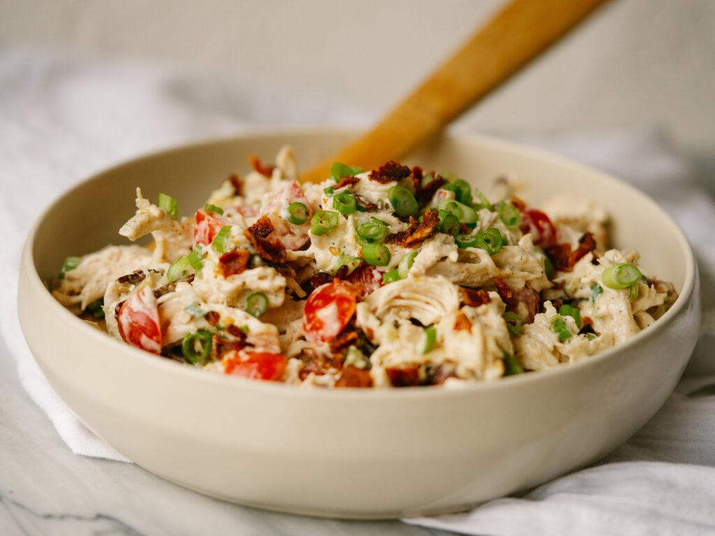 horizontal image bowl of BLT chicken salad