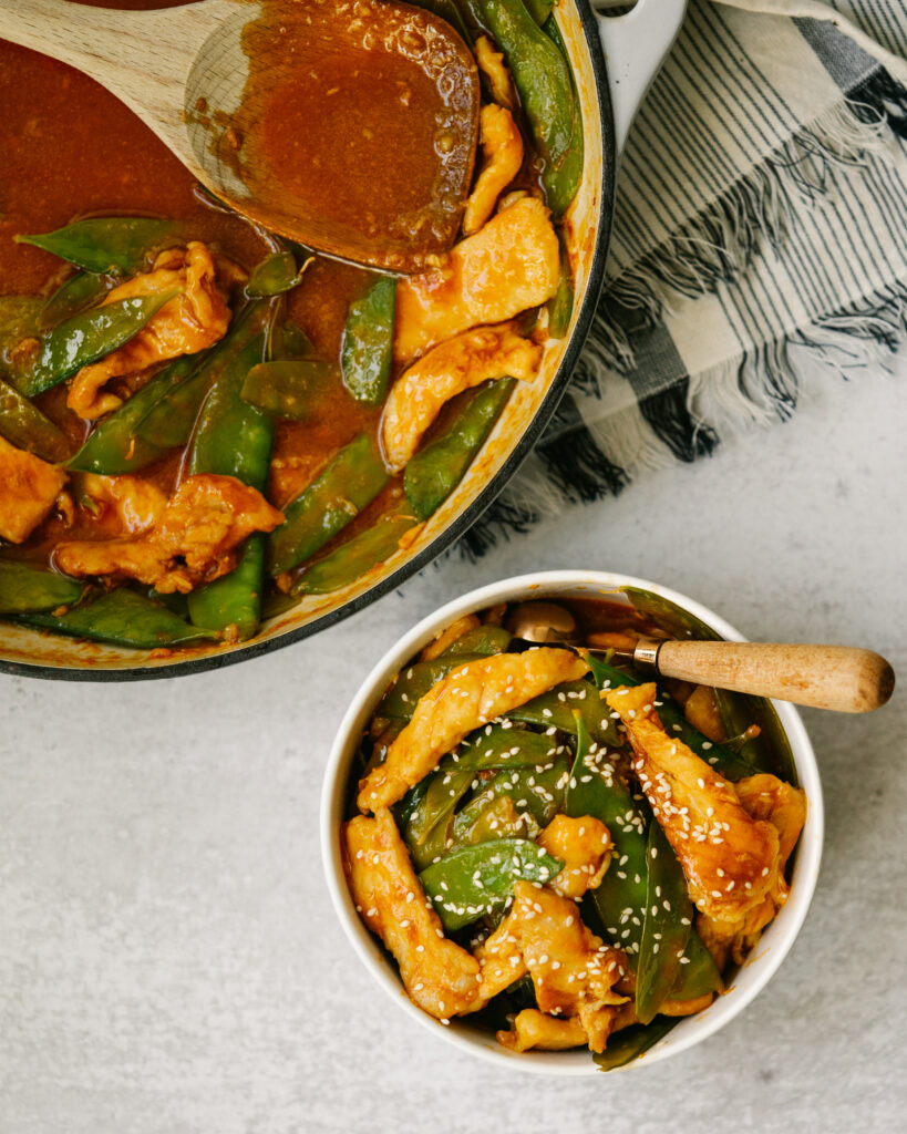 Above view of sweet and sour pork recipe in a pan and in a serving bowl