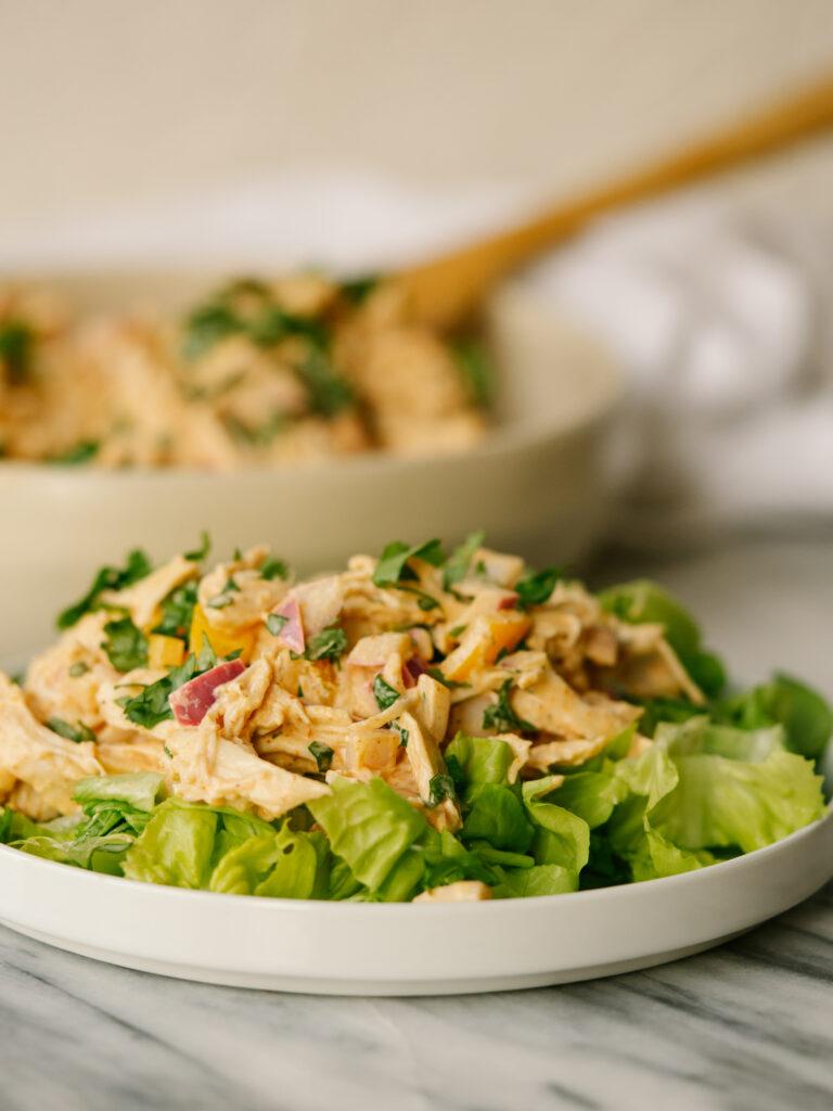 Side view of fajita chicken salad served on lettuce
