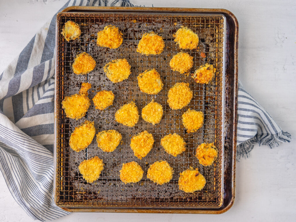 above view of air fryer fried pickles on a air fryer tray