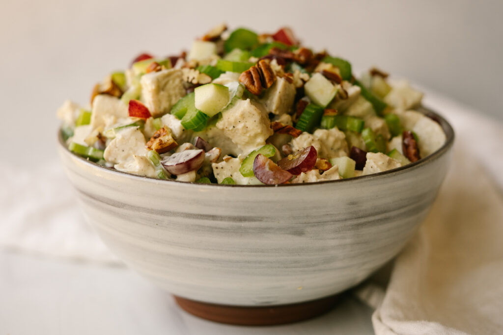 Side view of waldorf chicken salad recipe in a serving bowl