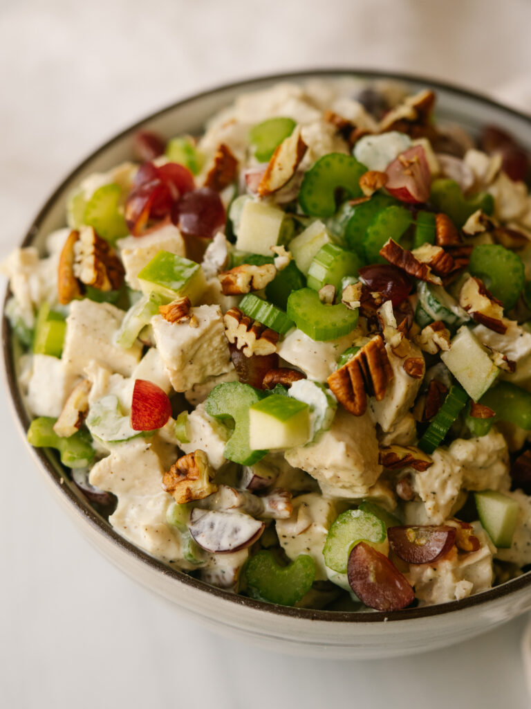 Close up three quarter view of whole30 chicken salad In a serving bowl