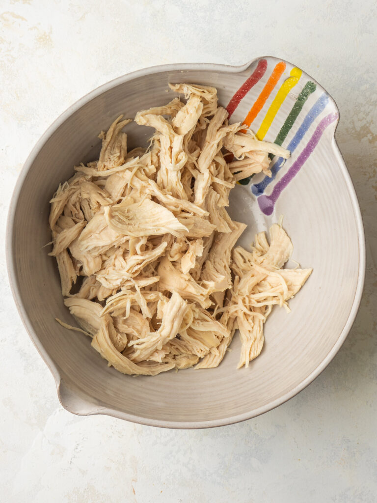Above view of shredded chicken in a bowl