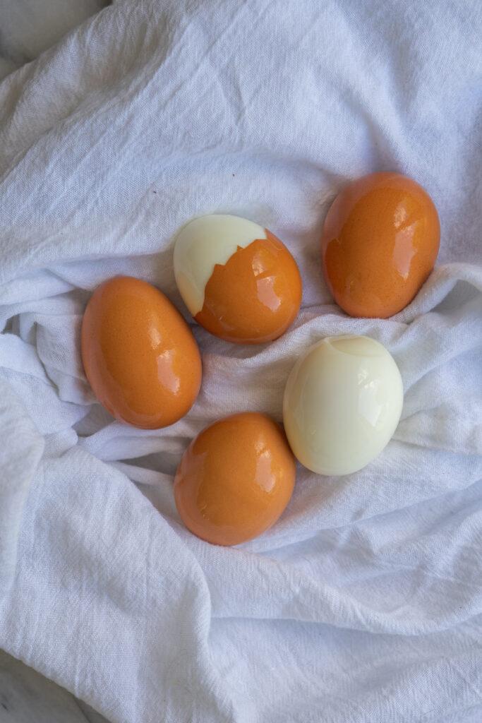 easily peeled hard boiled eggs sitting on a dish towel