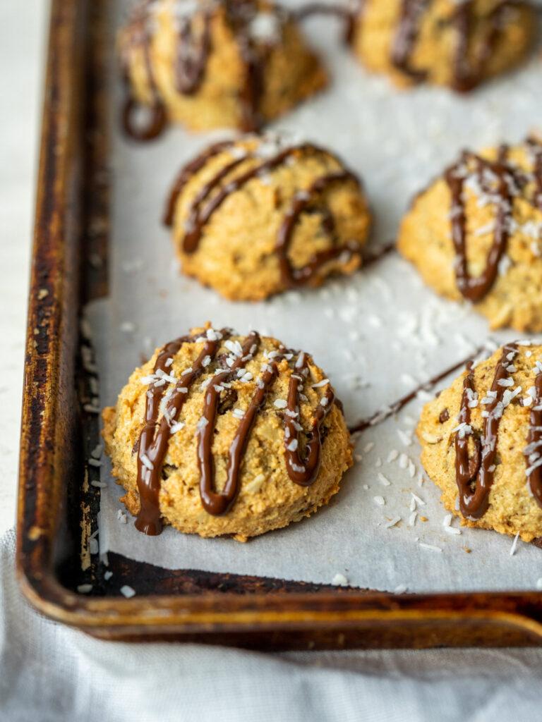 three quarter view of almond joy cookies on a sheet pan