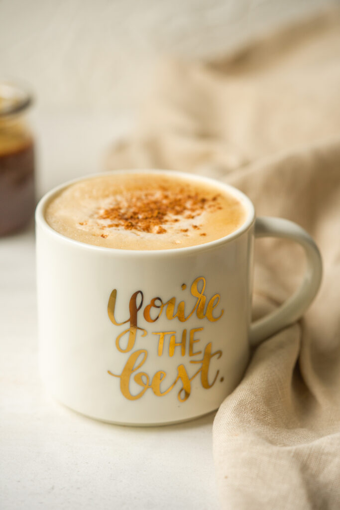 Side view of homemade Starbucks pumpkin spice latte recipe in a mug