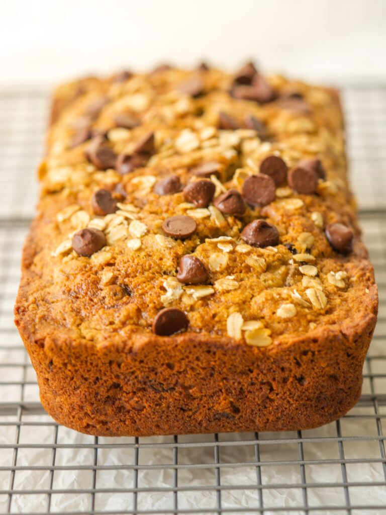 three quarter view of a full loaf of oatmeal chocolate chip banana bread