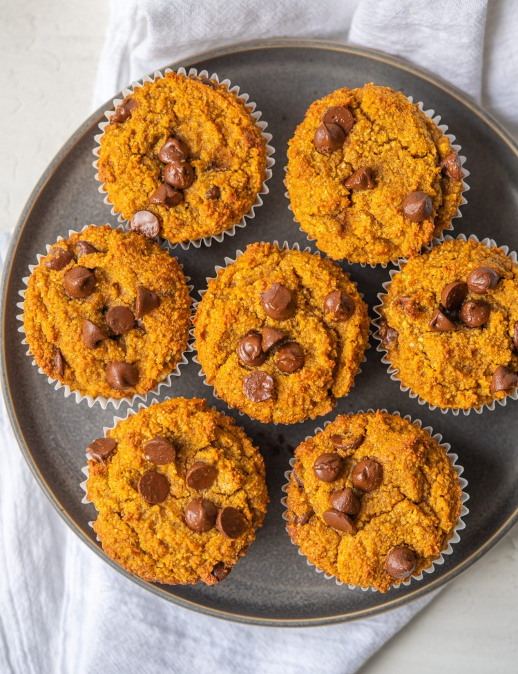 Pumpkin chocolate chip muffins on a serving plate