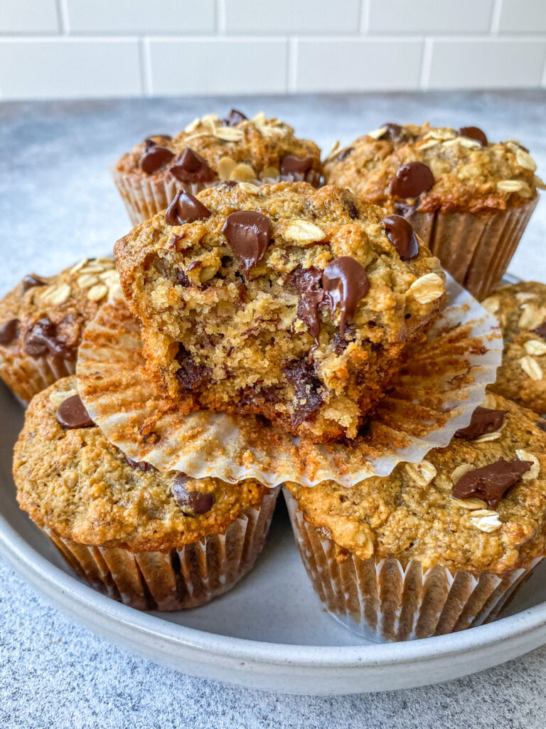 oatmeal banana bread muffins stacked on a plate
