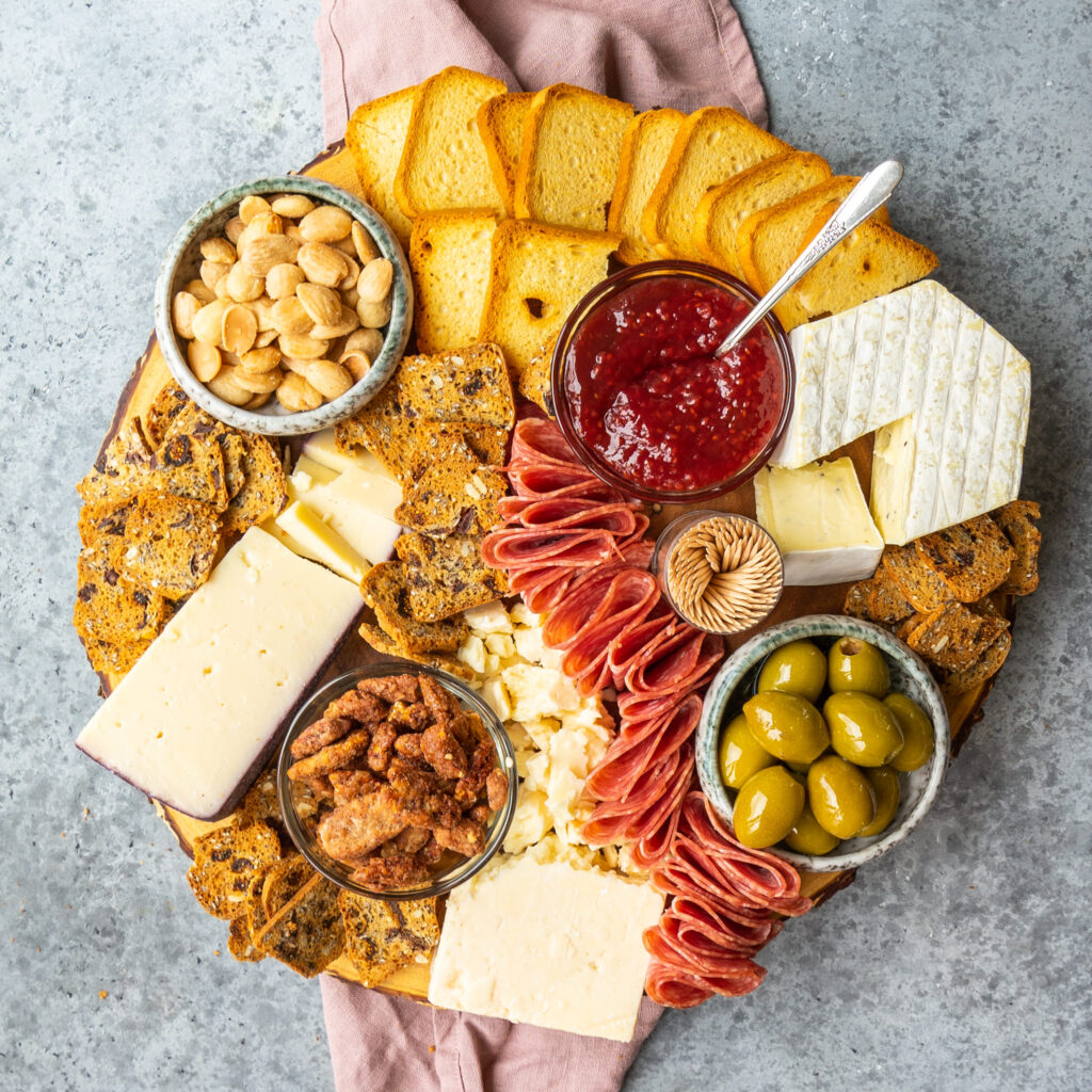 Above view of a trader joe's cheese board on a wooden serving platter