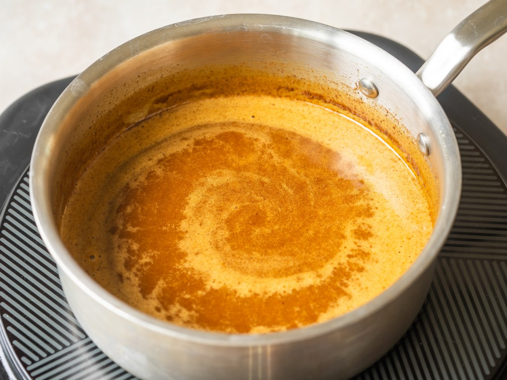 Gingerbread syrup simmering in a pot