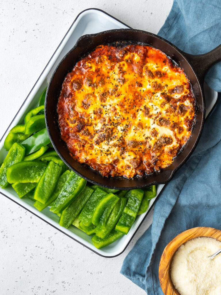 above view sausage pizza dip with green bell peppers