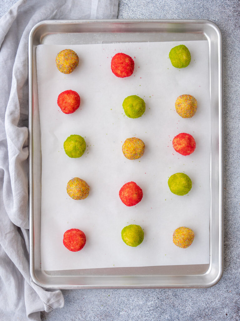 holiday almond cookie dough balls on a baking sheet