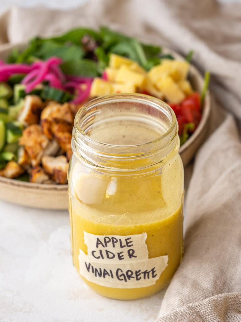 Jar of apple cider vinaigrette with a label on it