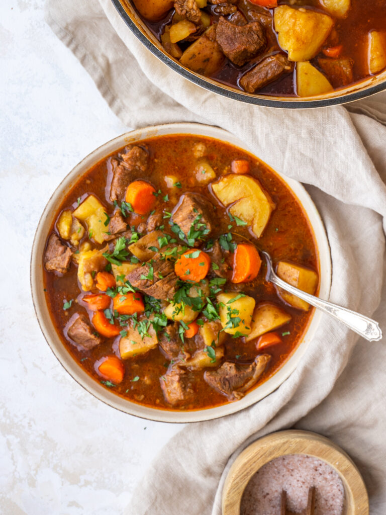 Above view of a bowl of Irish beef stew with parsley on top