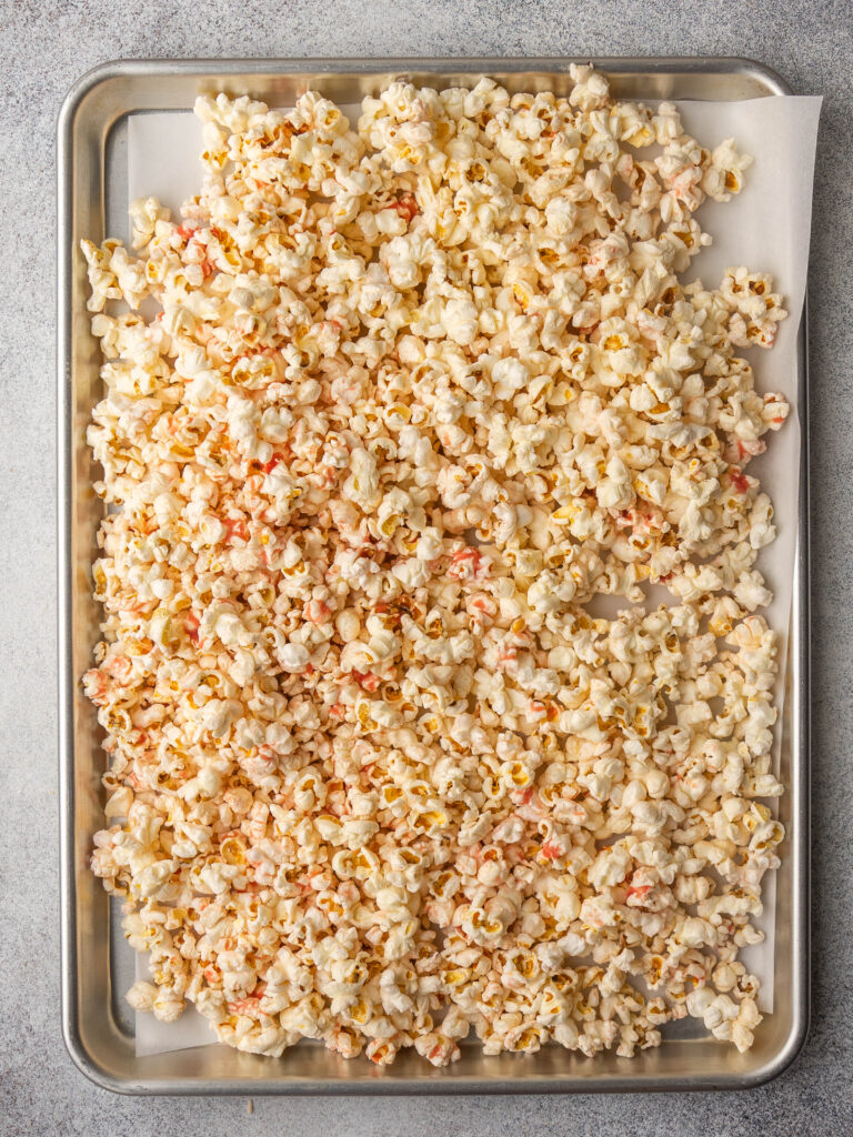 above view of a sheet pan with parchment paper and sweet and salty strawberry popcorn