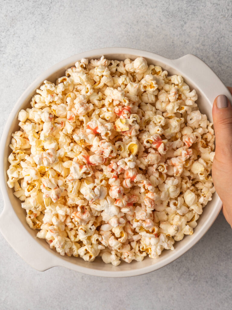 above view of a bowl of stove top popcorn with a strawberry seasoning on top