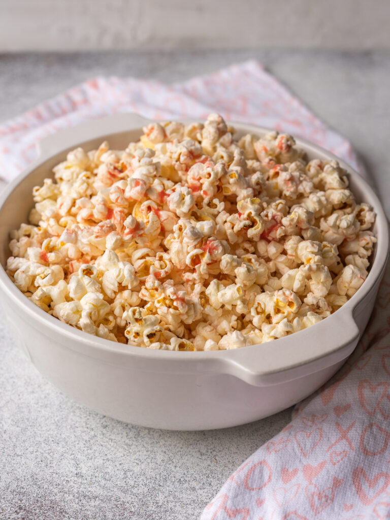 A three quarter view of a bowl of strawberry popcorn