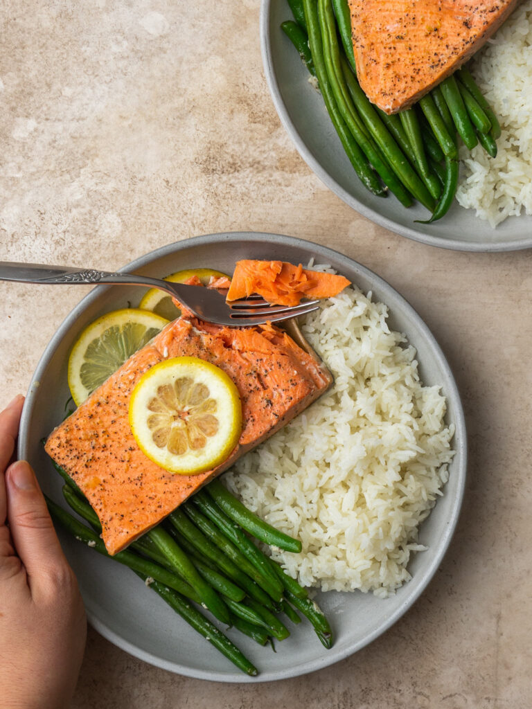 above view of instant pot salmon on a plate with green beans and rice
