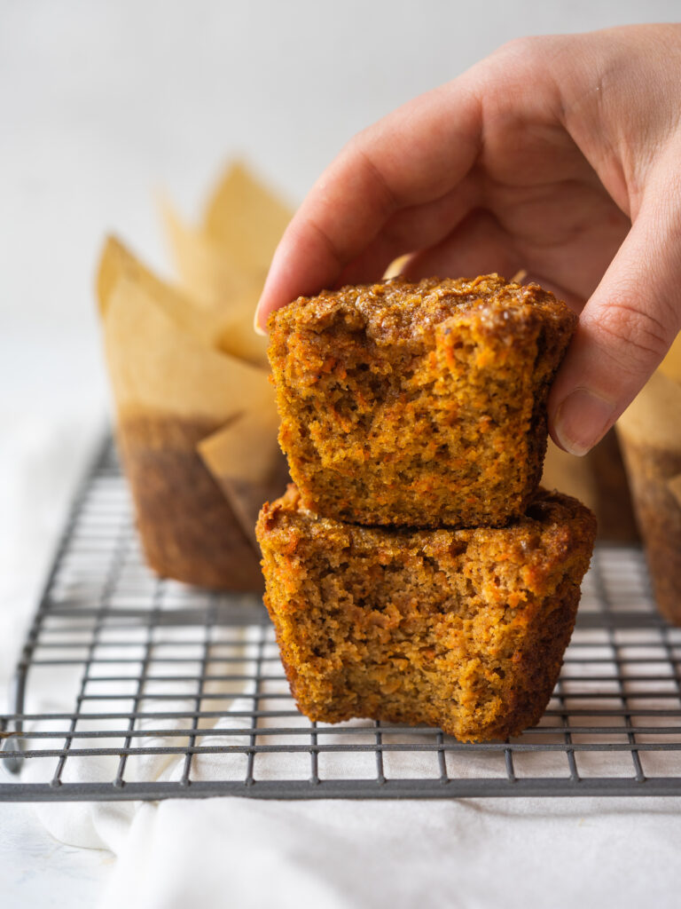 Side view of healthy carrot cake muffins with a bite out of them
