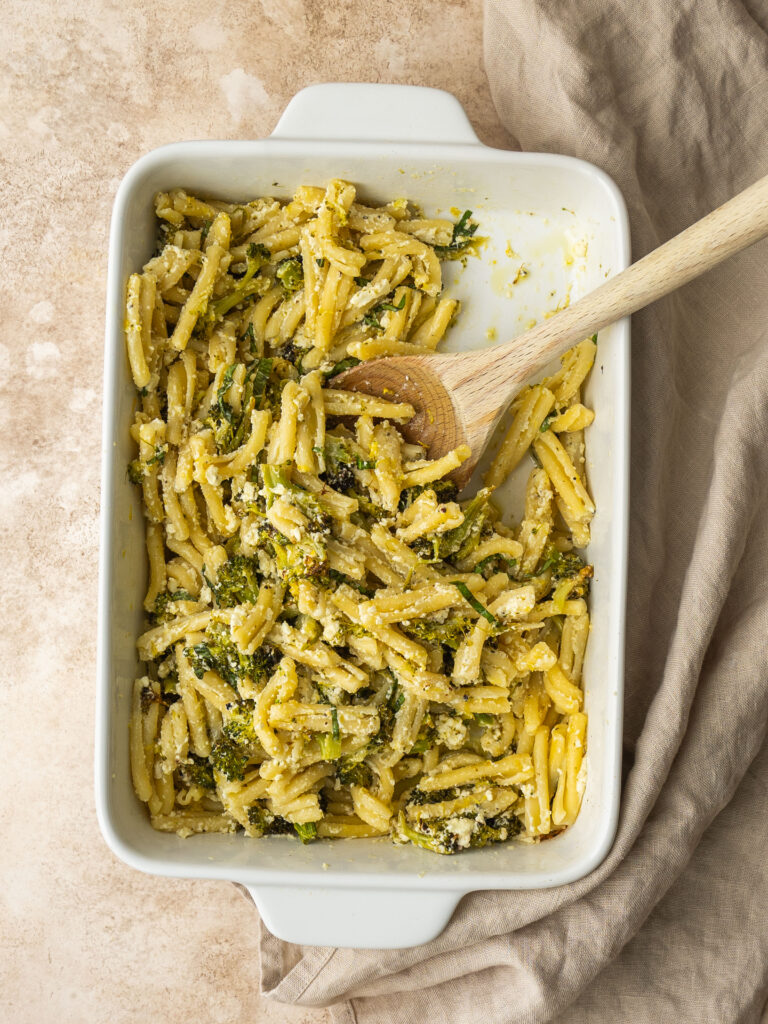 above view of a baking dish with baked feta and broccoli pasta