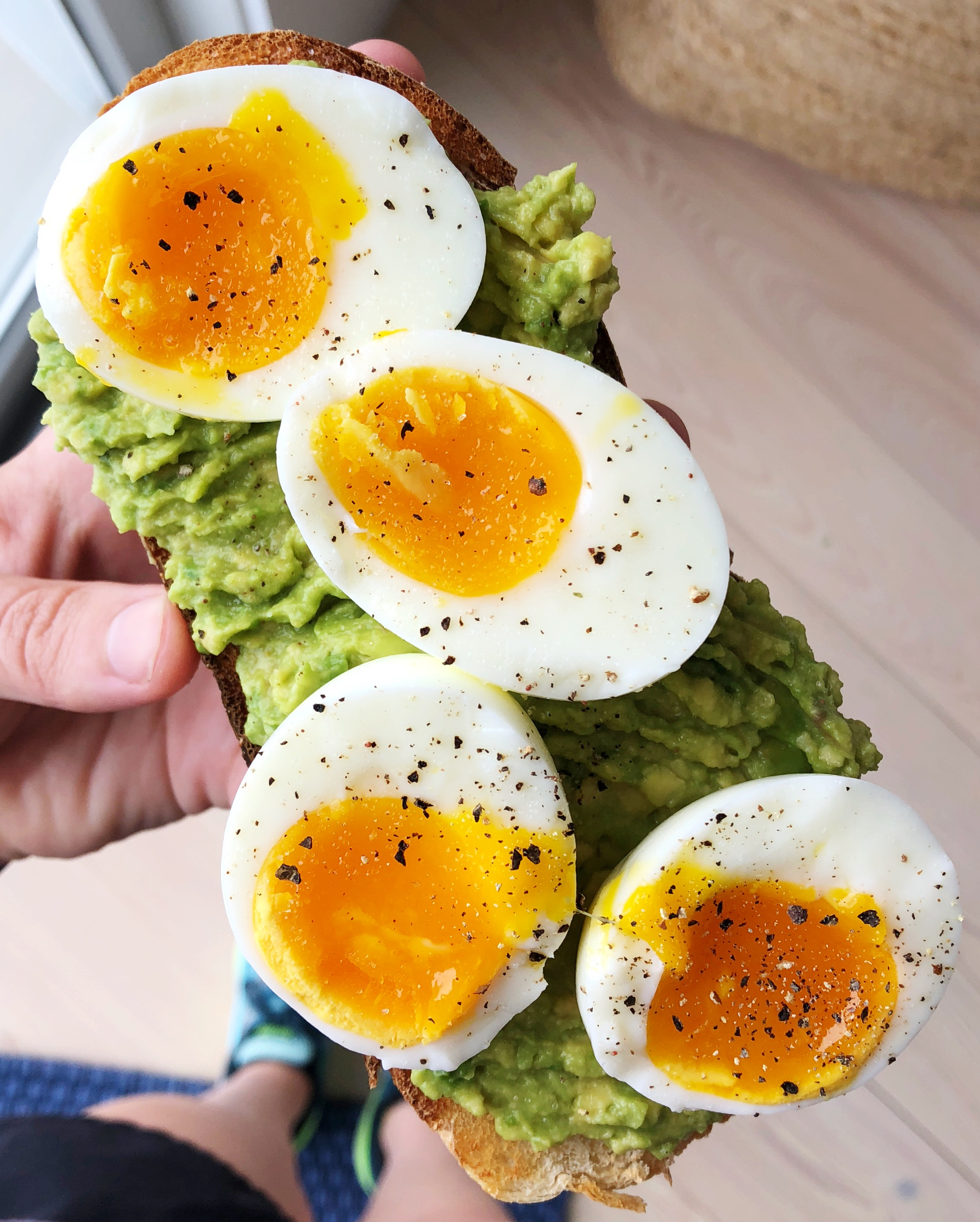 Above view of hard boiled eggs on a piece of toast
