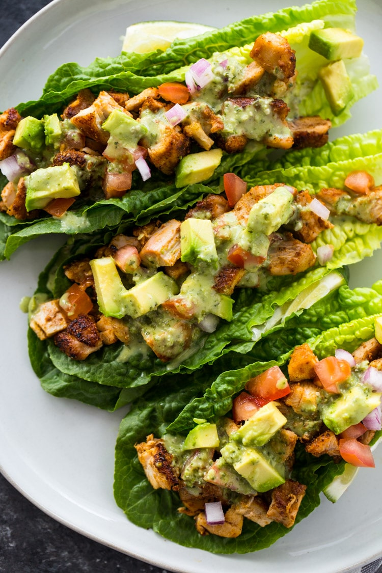 Three quarter view of chicken taco lettuce wraps from Gimme Delicious