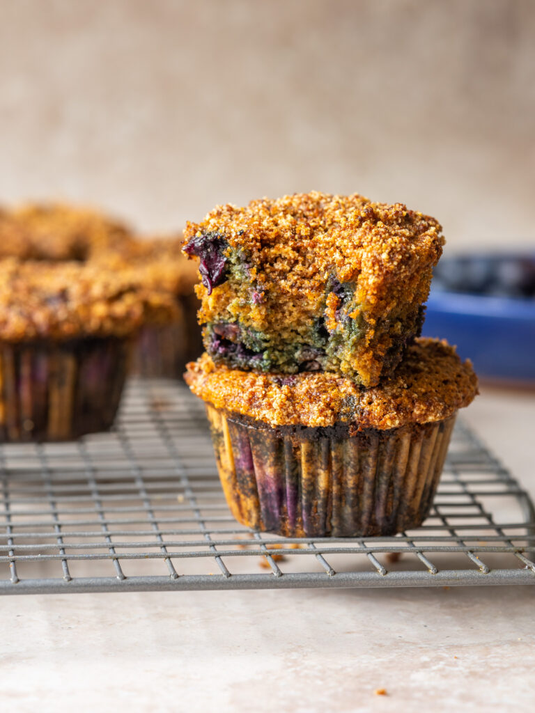 Side view of two Blueberry Coffee Cake Muffins stacked on top of one another