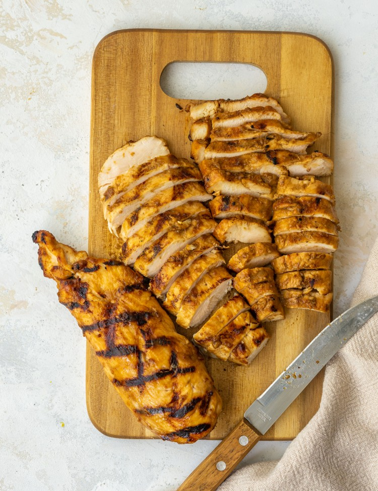 Above view of sliced balsamic chicken on a cutting board