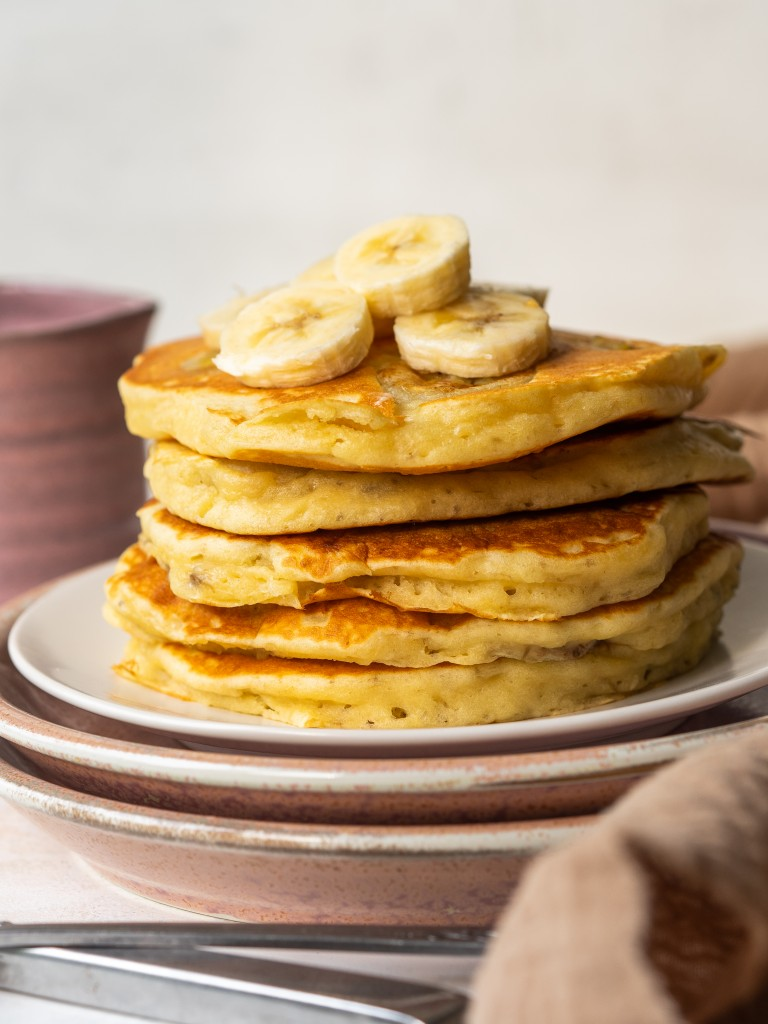 Side view of a stack of banana pancakes made with mashed bananas