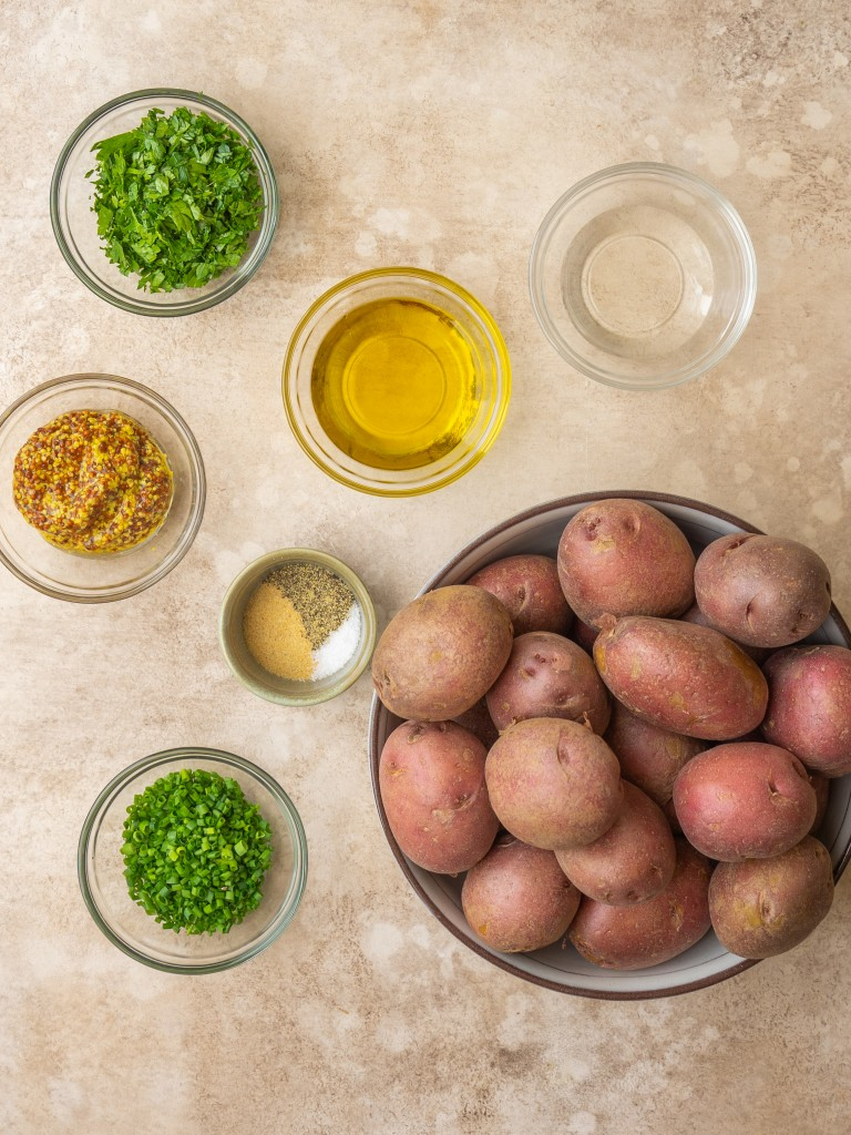 Above view of ingredients for herbed potato salad